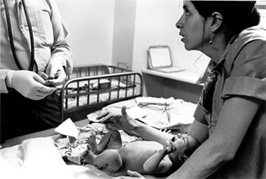 Nurse comforting baby